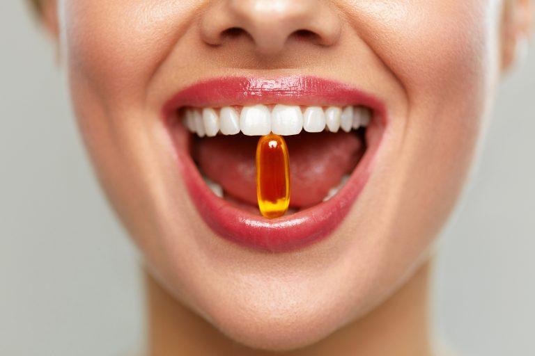 Woman taking a multivitamin